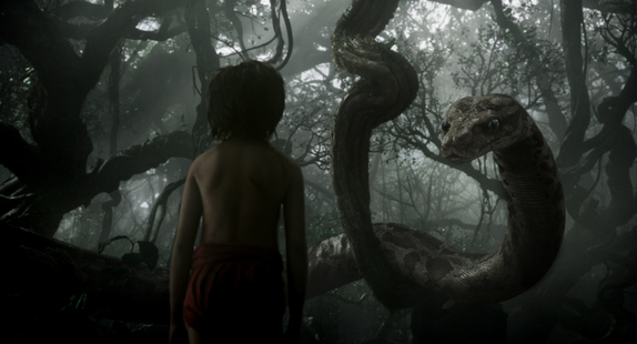 "Mowgli (newcomer Neel Sethi) meets Kaa (voice of Scarlett Johansson) in ""The Jungle Book"""