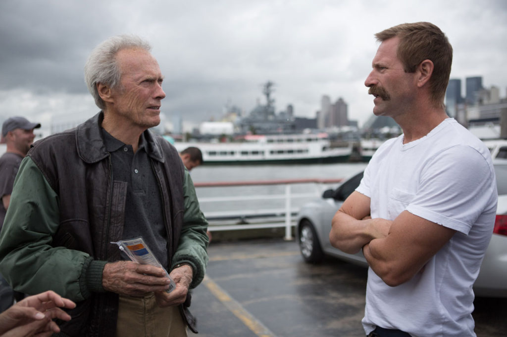 Clint Eastwood with Aaron Eckhart  on the set of Sully